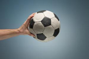 hands-holding-soccer-ball_155003-10331