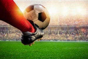 red-soccer-player-kicking-ball-action-stadium_43569-216