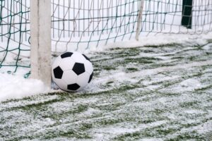 football-ball-near-soccer-goal-winter_85601-544